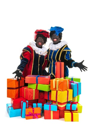 Dutch characters as black petes for typical Sinterklaas holidayswith jute bags Stock Photo - 16303539