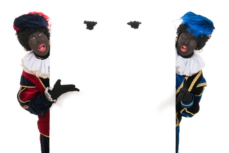 Dutch black petes for typical Sinterklaas holidays with white board Stock Photo - 16303600