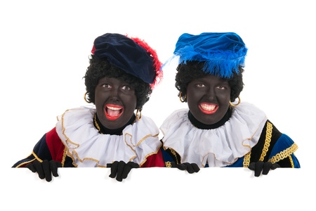 Dutch characters as black petes for typical Sinterklaas holidays with white board Stock Photo - 16303543