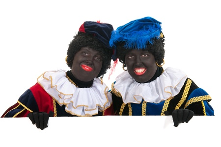 Dutch characters as black petes for typical Sinterklaas holidays with white board photo