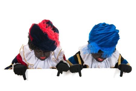 Dutch black petes for typical Sinterklaas holidays with white board Stockfoto