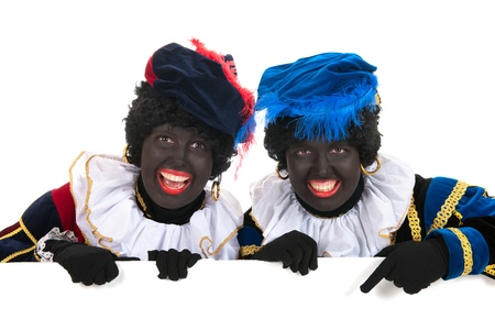 Dutch characters as black petes for typical Sinterklaas holidays with white board Stock Photo - 16303512