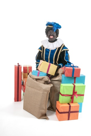 Dutch character as black pete for typical Sinterklaas holidays with many presents photo
