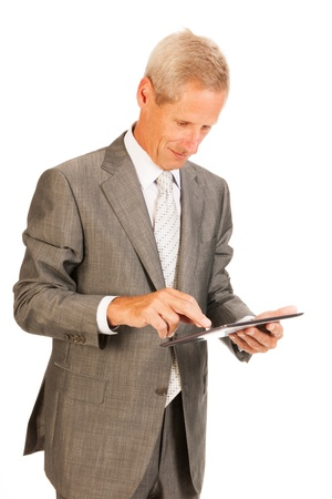 Senior business man with digital tablet isolated over white background Stock Photo - 16472746