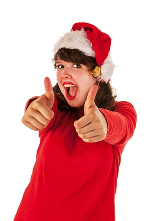 Winter girl with red sweater and hat of Santa Claus is doiing thumbs up Stock Photo
