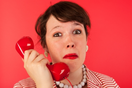 bereavement: Woman crying while having a sad phone call