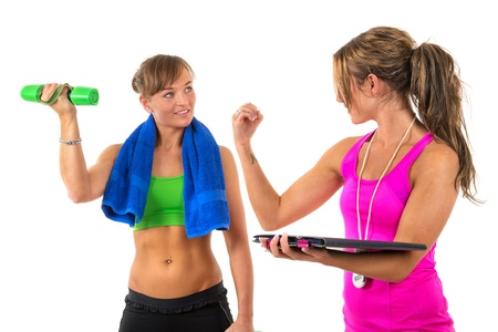 Young woman is training muscles by female coach Stock Photo