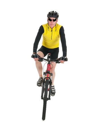 Active mountain biker rides in studio isolated over white background