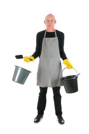 Cleaner with bucket and dustpan and brush standing in studio photo