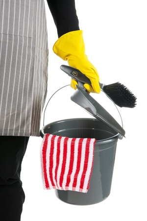 Detail of a cleaner with bucket and dustpan and brush photo