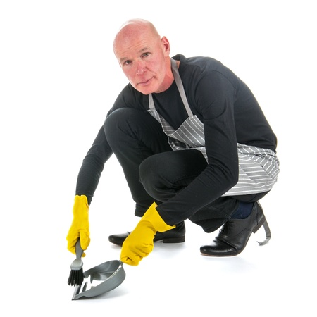 houseman: Working houseman with dustpan and brush isolated over white background