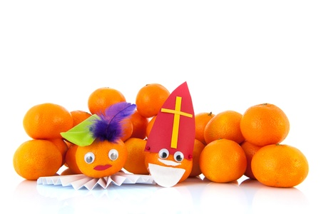 mandarins: Dutch Sinterklaas and Black Pete as mandarins isolated over white background