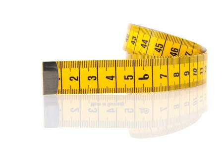 measuring: Rolled measuring lint isolated over white background with reflection