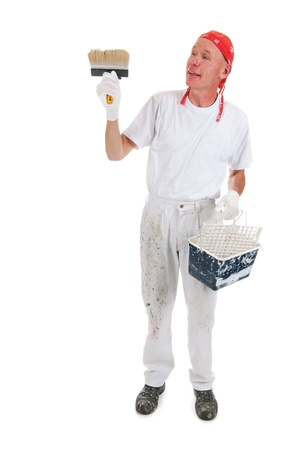 Painter in studio working with big block brush for ceiling Stock Photo - 16662420