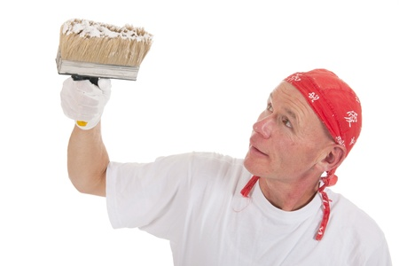 Painter in studio working with big block brush for ceiling Stock Photo - 16662415
