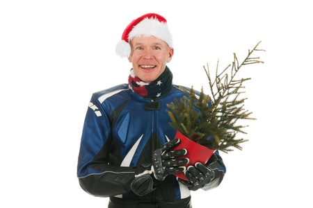 Portrait of a adult motor biker as Santa Claus with Christmas tree isolated over white background Stock Photo - 16662370