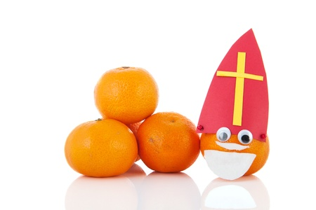 Dutch Sinterklaas as mandarin isolated over white background Stock Photo - 16677457