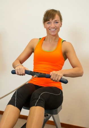 Woman rowing in the sport club photo