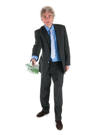 El hombre de negocios est� dando dinero Foto de archivo - 16880323