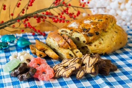 christmas paste: currant bread with almond paste and sugar and other sweet delicatessen for Christmas Stock Photo