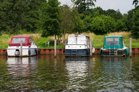 Motor yachts at the river in little harbor Stock Photo