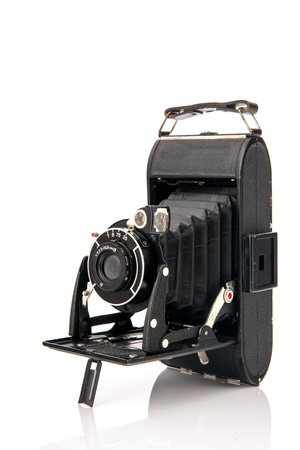 Old black photo camera isolated over white background Stock Photo - 17171283