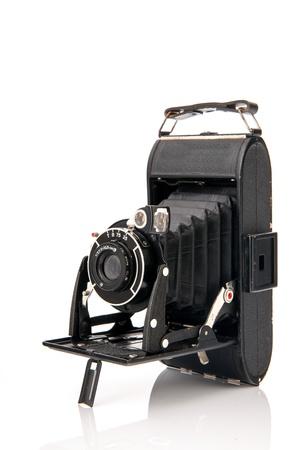 Old black photo camera isolated over white background Stock Photo - 17171283