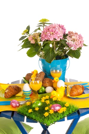 Detail easter table in blue and yellow photo