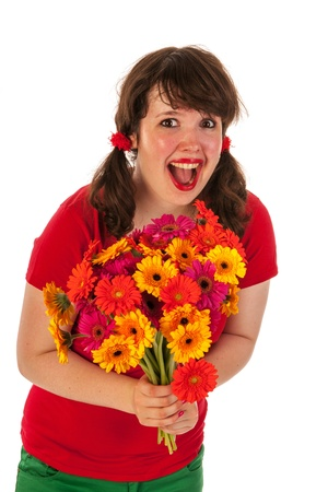 Young brunette girl is happy with bouquet Gerber flowers photo
