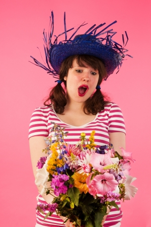 Young woman is happy with bouquet flowers Stock Photo - 17362675