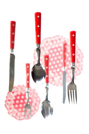 Floating red cutlery and lace cloths  photo
