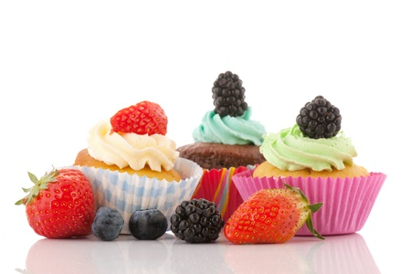 brambleberries: Strawberry cupcake with buttercream and fresh fruit isolated over white background