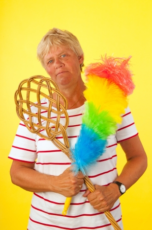 Tough elderly woman ready for cleaning the house photo