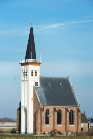 White little church in small village Den Hoorn at Dutch island Texel photo