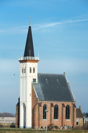 hoorn: White little church in small village Den Hoorn at Dutch island Texel