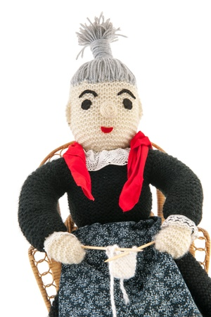 hand knitted grandma sitting on chair photo
