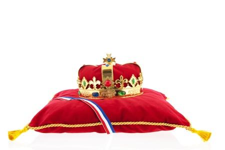 Golden crown on red velvet pillow for coronation in Holland Stock Photo - 17986574