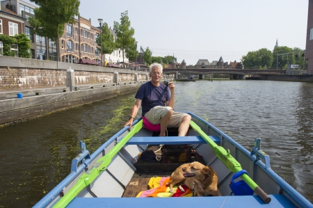 eem: Man with boat and dog in Amersfoort at the Eem river