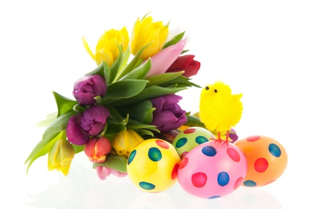 Painted easter eggs with colorful bouquet tulips and chick in spring photo