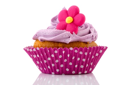 Pink cupcake with flower and buttercream photo