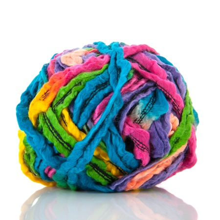 Modern ball wool in many colors isolated over white background photo