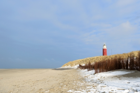 texel: Winter at the coast from Dutch wadden island Texel with lighthouse