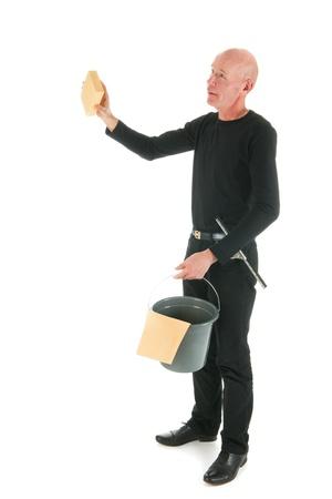 houseman: Window cleaner working with sponge