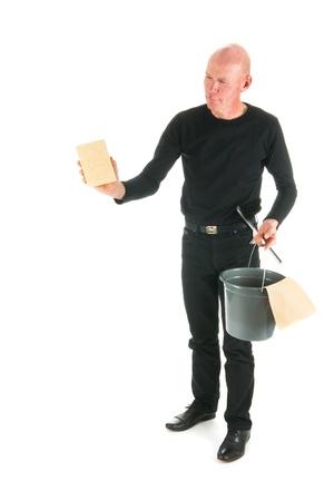 houseman: Window cleaner working with wiper