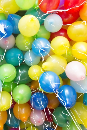 Many colorful balloons with ribbons