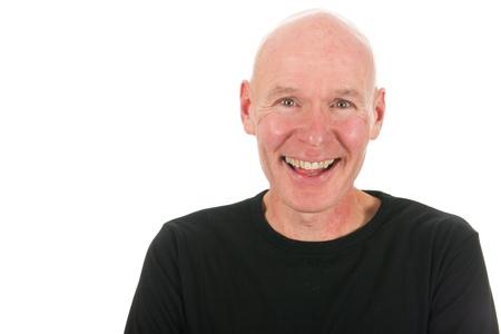bald man: hombre calvo adulto de pie en el estudio y que parece enojado