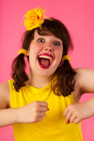 tailes: Girl is making lits of fun in colorful portrait Stock Photo