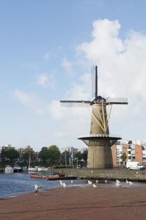 Historic windmill De Distilleerketel at Delfshaven Dutch Rotterdam Stock Photo - 18203025