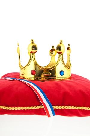 Golden crown on red velvet pillow for coronation in Holland Stock Photo - 18501937