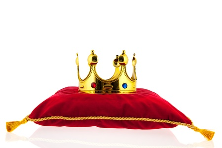 Golden crown on red velvet pillow for coronation Stock Photo - 18501883